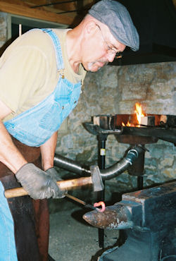 Chris Hubbard, shown here, is the Glidden Homestead's chief blacksmith at the Phineas Vaughan Blacksmith Shop.