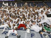The NIU Huskies celebrate after winning the 2014 Mid-American Conference Football Championship. They beat Bowling Green State University 51-17 on Dec. 5.