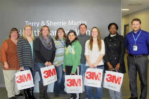 The Community Support Group at 3M in DeKalb awarded Littmann Stethoscopes to five first-year nursing students at Kishwaukee College. Pictured on campus with the stethoscopes are, L to R, Kelly Soost, Coordinator of Nursing at Kishwaukee College; Melanie Bouland, Steward; Bridget Crofoot, Sycamore; Donna Engh, 3M Community Support Group; Kristina Hudak, DeKalb; Jay McGee, 3M Community Support Group; Elizabeth Smith, DeKalb; Stelle Njindam, DeKalb; and Jon Pruitt, 3M Community Support Group.