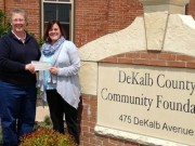 DCCF Board Member Alethia Hummel presents a Community Needs grant to Nancy Mullen, Executive Director of Youth Outlook, for a grant awarded in Spring 2015.