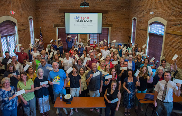 Pictured: Representatives from the 68 participating nonprofits gathered together during the check presentation on June 14.
