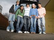 Diverse Teens Standing at Back of Car