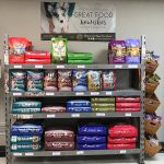 Huckleberry's Pet Parlor: Buy one bag of dog or cat food, and receive a 5 pound bag for FREE!
